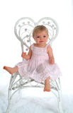Baby in White Wicker Chair Royalty Free Stock Photo