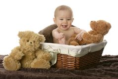Baby in wicker basket Stock Photo