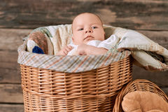Baby in a willow basket. stock photography