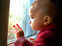 Baby Through Window Stock Image