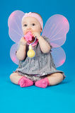 Baby with wings and toy Royalty Free Stock Photography