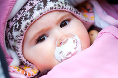 Baby in winter. A few months old baby outdoor in warm clothes in a cold winter day royalty free stock photography