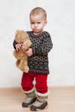 Baby in winter clothes with toy. Pretty Caucasian young girl in winter clothes Royalty Free Stock Photography