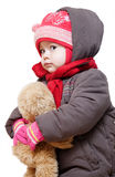 Baby in winter clothes on a white background. Pretty Caucasian young girl in winter clothes on a white background Royalty Free Stock Image