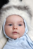 Baby in winter hat Stock Image