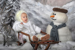 Baby on a winter landscape Royalty Free Stock Photos