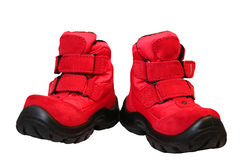 Baby winter shoes. Red children's winter warm boots. Isolated Stock Photos
