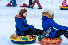 Baby winter sledding on the Ural River Stock Image