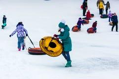 Baby winter sledding on the Ural River. Stock Image