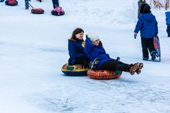 Baby winter sledding on the Ural River. Royalty Free Stock Photo