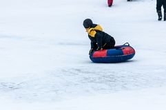 Baby winter sledding on the Ural River, Royalty Free Stock Images