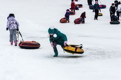 Baby winter sledding on the Ural River, Stock Image