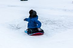 Baby winter sledding on the Ural River, Stock Photography