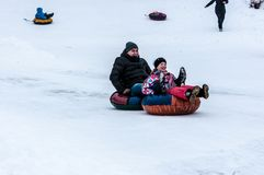 Baby winter sledding on the Ural River, Stock Images