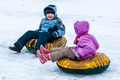 Baby winter sledding on the Ural River, Royalty Free Stock Photo