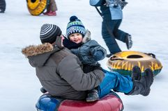 Baby winter sledding on the Ural River, Royalty Free Stock Photos