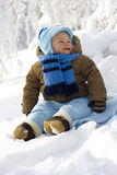 Baby in winter on snow Stock Images