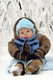 Baby in winter on snow Royalty Free Stock Image
