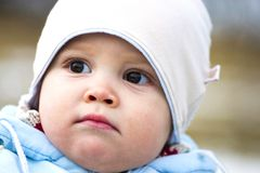 Baby in winters clothing Stock Images