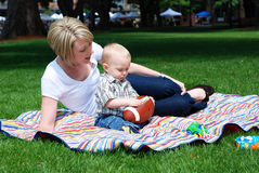Baby With Football As Mom Watches - Horizontal Royalty Free Stock Photos