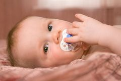 Baby With Pacifier Soother Stock Images
