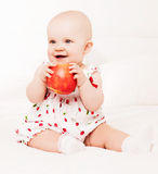 Baby withapple Stock Image