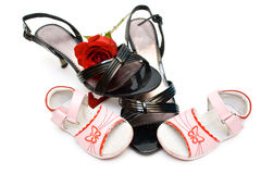 Baby and woman shoes, with a rose inside, isolated Stock Photo