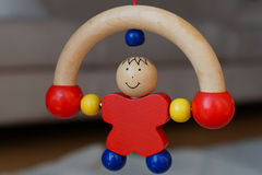 Baby wood toy - rolling man Royalty Free Stock Photo