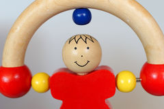 Baby wood toy - rolling man Royalty Free Stock Images