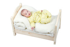 Baby in wooden crib Stock Photo