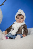 Baby with a wool cap. Is a baby with a wool cap stock image