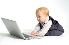 Baby working Stock Photography