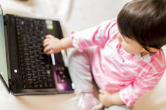 Baby working on laptop Stock Images