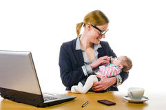 Baby on Workplace Stock Images