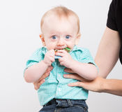 Baby Worried with Paper in Mouth Royalty Free Stock Photos