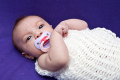 Baby in Wrap Stock Photo
