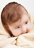 Baby wrapped the bath towel Stock Photos