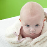 Baby wrapped in a bath towel.bis stock images