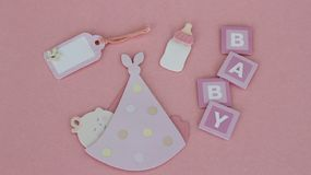 Baby items on pink background stock photography