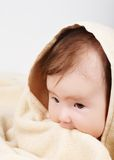 Baby wrapped in the buth towel Stock Photos