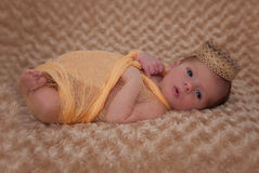 Baby wrapped in muslin with crown Royalty Free Stock Photos