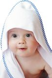 Baby wrapped in towel on white background Royalty Free Stock Image