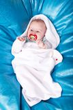 Baby wrapped up in the white swaddling band Royalty Free Stock Images