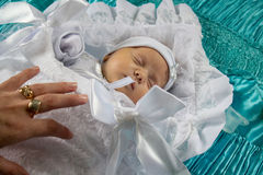 Baby wrapped in a white sheet. Baptism baby sleeps in a white sheet Stock Photography