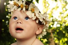 Baby with a wreath stock images