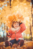 Baby with wreath in the autumn park Royalty Free Stock Images