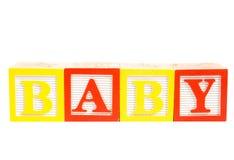 Baby written in wooden blocks. Isolated on white stock photos