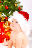 Baby in xmas hat Stock Photos
