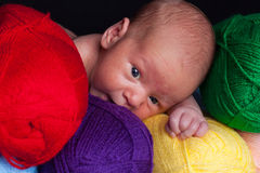 Baby in yarn Stock Image