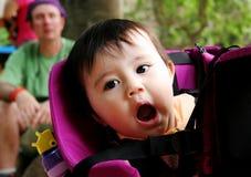 Baby yawning Stock Images